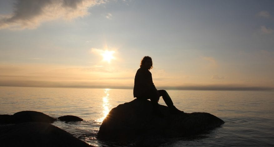 A Girl is Posing for a Picture in Sunset