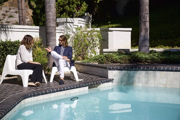 Two people talking at the pool area