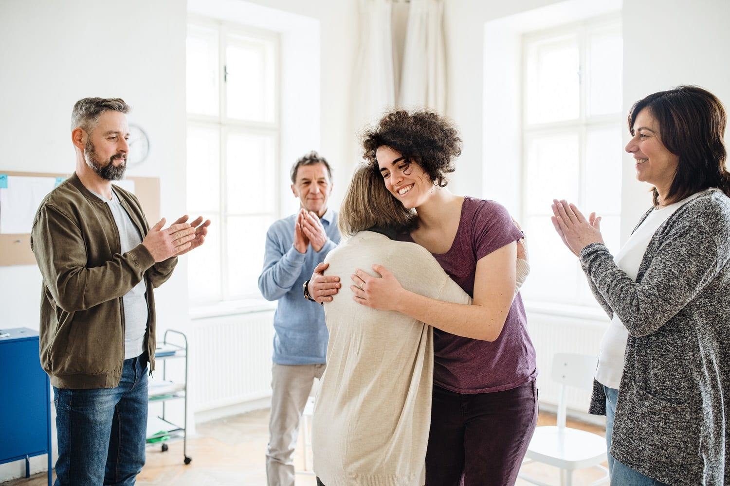 Group of men and women during group therapy