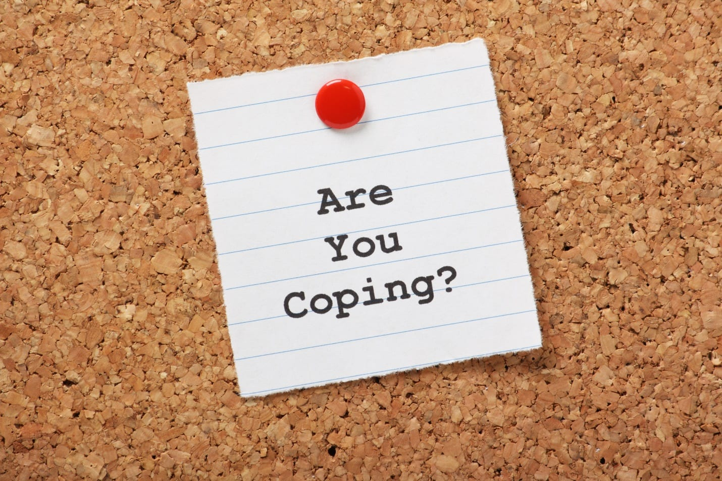 Are You Coping? on a paper note pinned to a cork notice board.