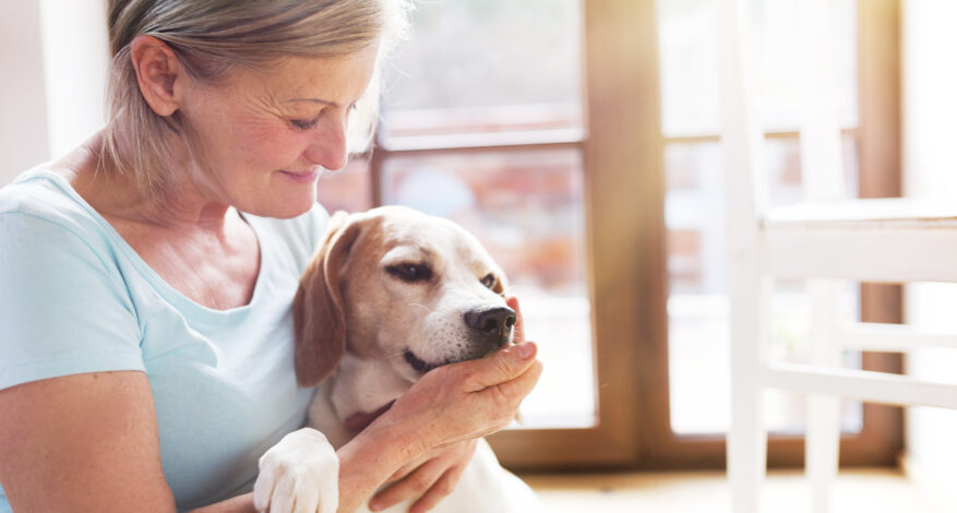 Senior woman with her dog   pet therapy san diego