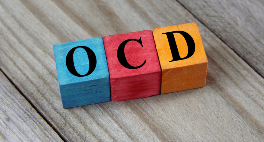 OCD (Obsessive Compulsive Disorder) text on colorful wooden cube
